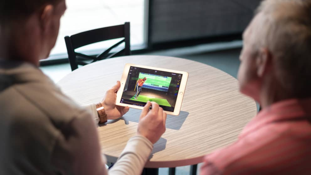 Analyzing golf swing with patient using iPad